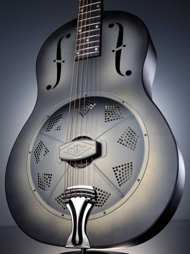 Under the 'colander' front of this guitar is the aluminium resonator cone