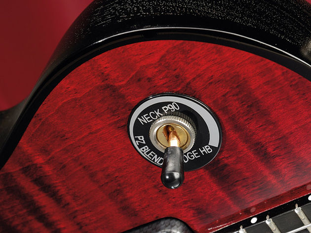 The switch tip rotates to blend in the piezo pickup with the P90 and humbucker