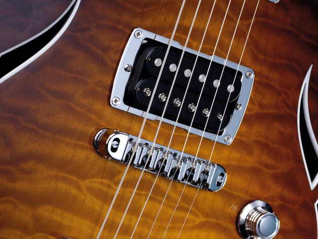 The bridge has roller saddles to help tuning stability with the Bigsby vibrato