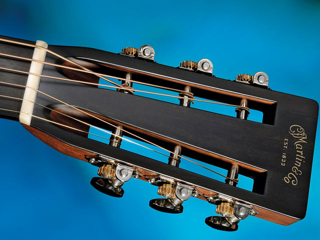Side-mounted Waverly 4063 tuners adorn the slotted headstock