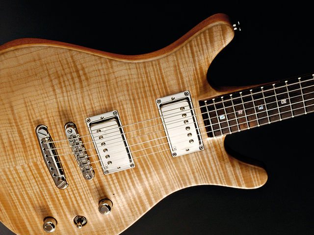 That beautiful maple top looks even better strapped on