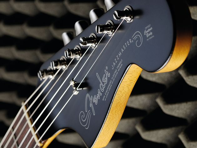 The black-painted headstock gives both guitars a distinctive look