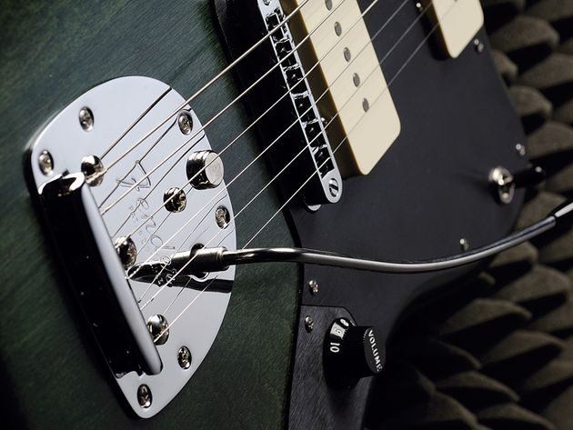 The Thurston Moore Jazzmaster sports a Gibson-style adjust-o-matic bridge