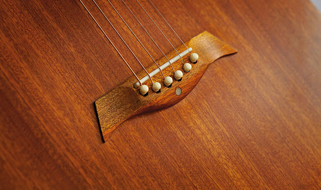 The elegantly shaped mahogany bridge is one area in which Anderwood has evolved the early Weissenborn design