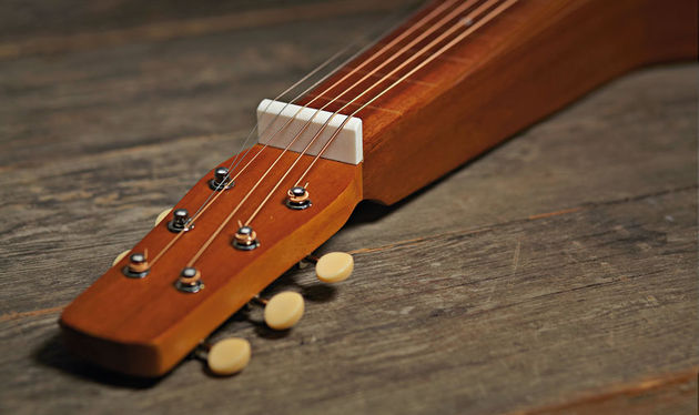 The bone nut lifts the strings just under 20mm off the 'board, meaning you can be very spirited with your slide
