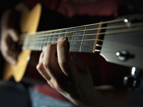 Playing acoustic guitar: fingerstyle