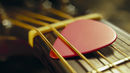 Playing acoustic guitar: plectrum technique