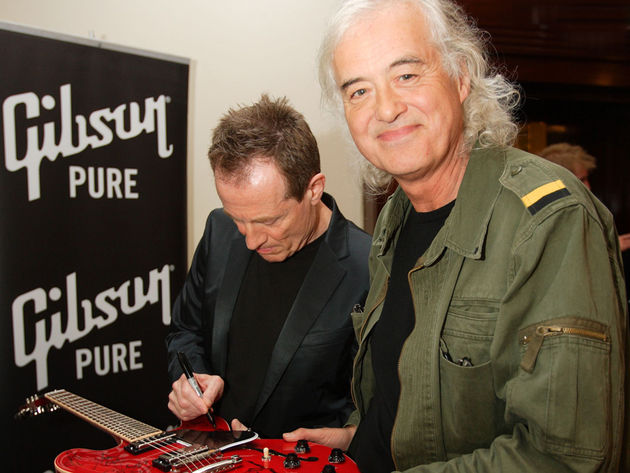 Led Zeppelin legends Jimmy Page and John Paul Jones signing the ES-335