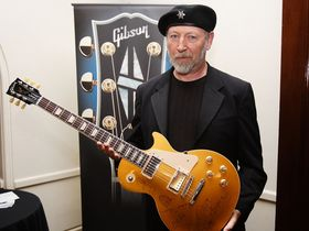 Mojo auctions off signed Les Paul for War Child