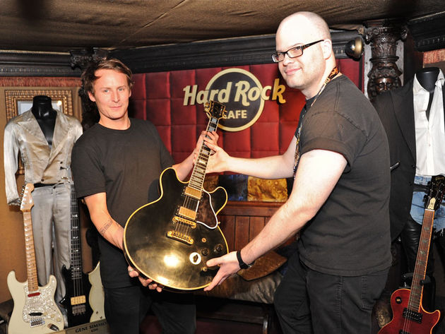 UK singer/songwriter Ben Howard donating one of his old guitars