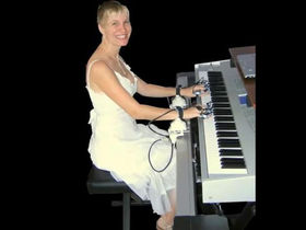 Concert Hands: the strap-in electronic piano teacher