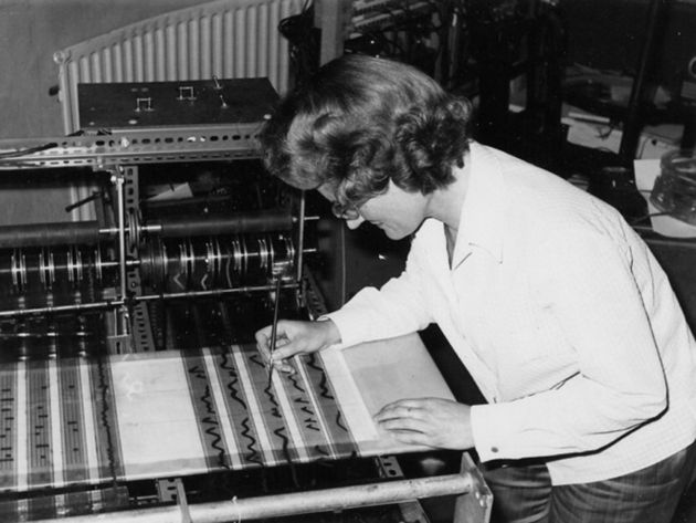 Daphne Oram at work on her machine.