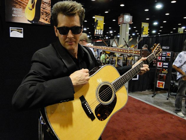 The real Man In Black played an original D-45. Our celebrity impersonator poses with the D-45E Retro.