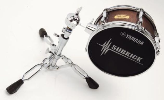 The stand enables vertical positioning in front of the bass drum.