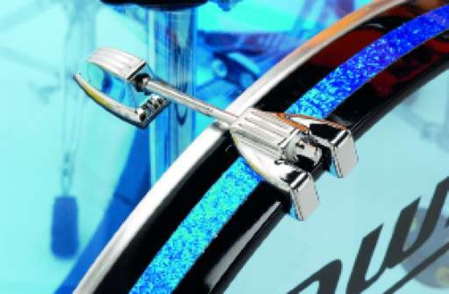 The bass drum has wooden hoops inlaid with blue glitter.