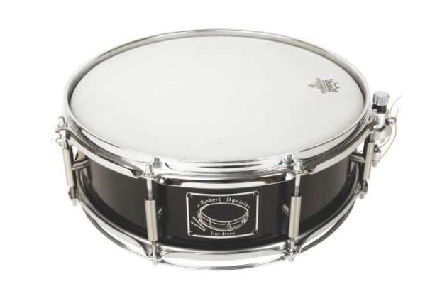 The bog oak snare is the only standard size drum here, showing the flexibility of Fine Drums