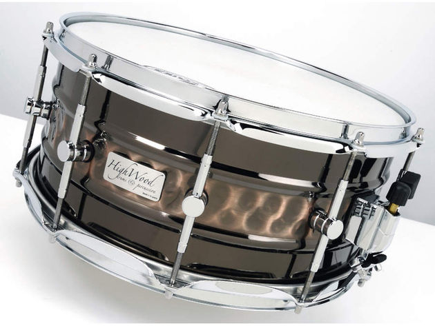 The hand-hammered shells, despite being finished in black nickel plate, boast a copper-like sheen