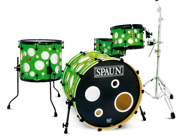 The multi-ports on the front bass drum head echo the holes in the drilled outer shells of the kit