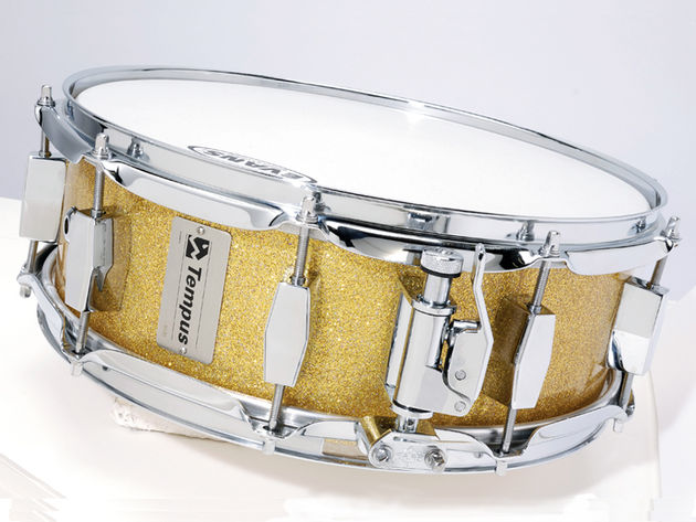 The inside of the gold fibreglass drum is translucent, while the other two are black with a honeycombed fabric