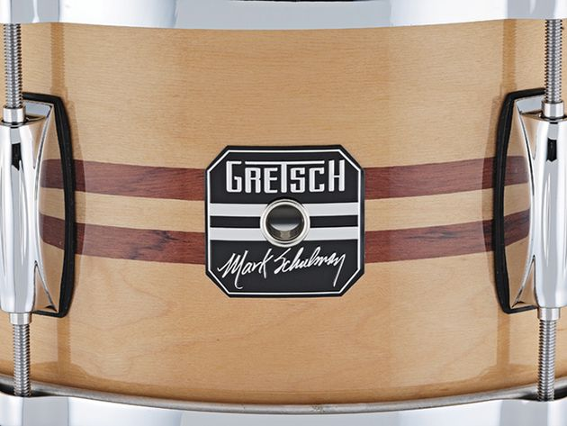 The light natural maple finish features an inlay of two strips of Bubinga.