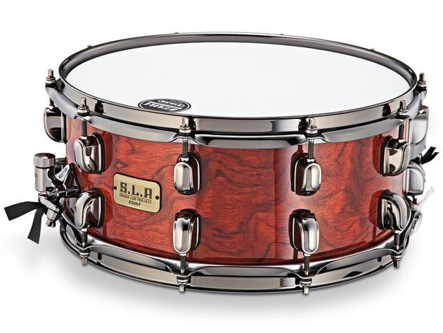 The SLP G-Bubinga snare features Tama's gun turret-style Starclassic lugs.