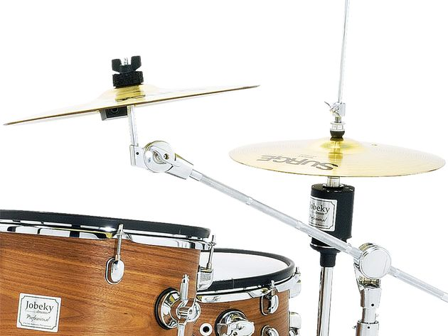 Cymbals are brass with a touch-sensitive plastic damping ring installed on their underside