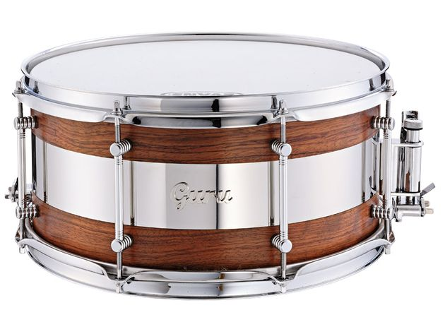 The snare has a two-part, steam-bent single-ply bubinga shell with a central panel of stainless steel.