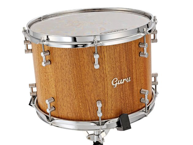 These gorgeous toms and bass drum are crafted from solid staves of reclaimed 100-year-old mahogany.