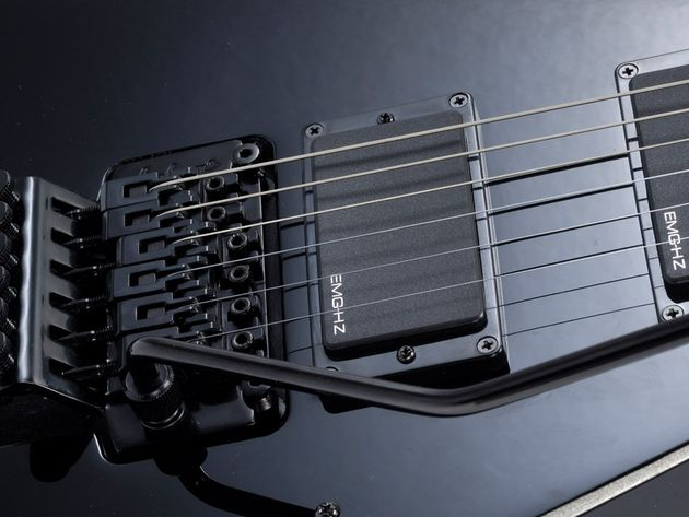 The PDX has a licensed vibrato and passive pickups for a low price.