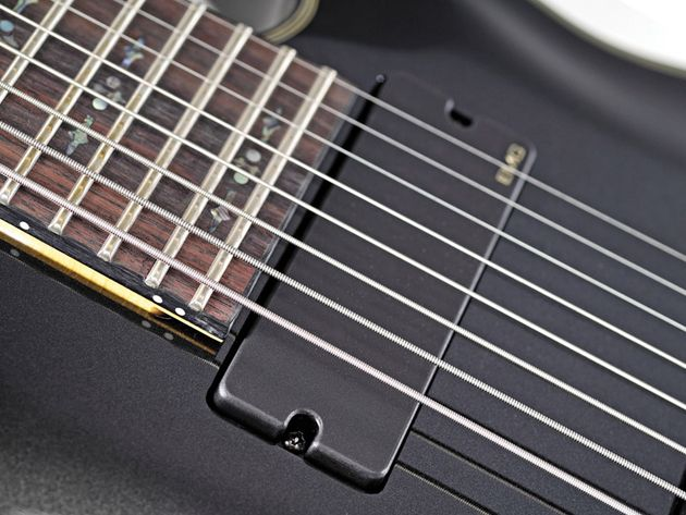 Schecter's Damien Elite 8 breaks eight-string guitars into the mid-price point.