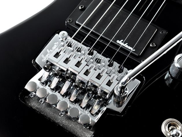 A Jackson licensed Floyd Rose vibrato keeps you stable after divebombing.