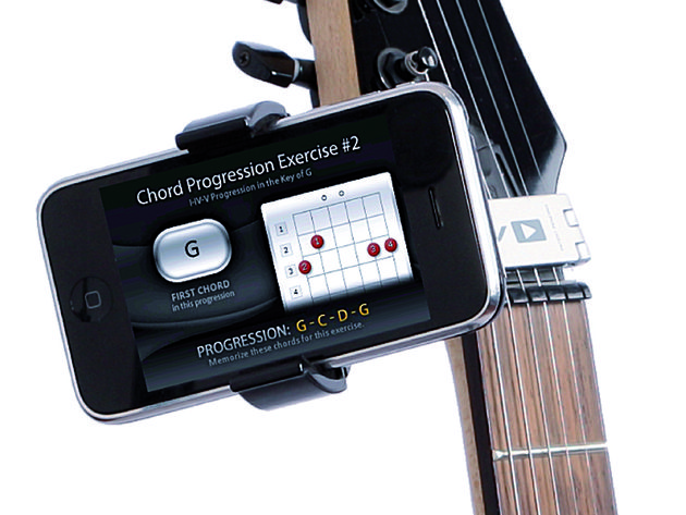 Castiv's Guitar Sidekick locks handily to the strings at your instrument's headstock.