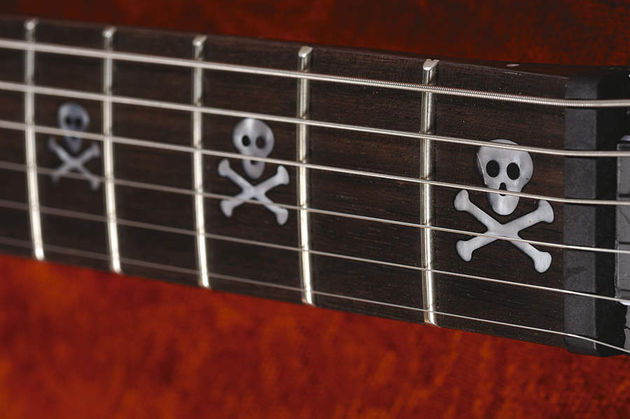 Skull fret markers, for metal kids only.
