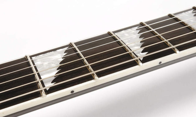 The saw-tooth inlays speak of its metal pedigree