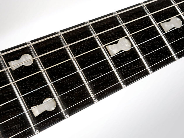 The ebony fretboard comes with neat keyhole markers