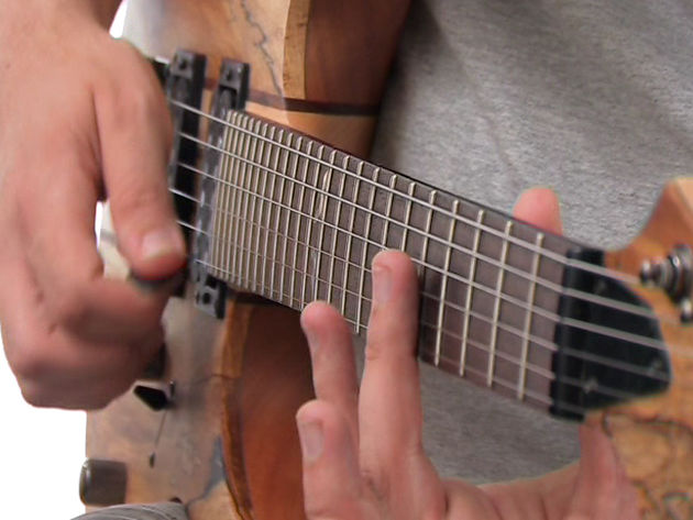learn how to play natural harmonics using our video, tab and backing track