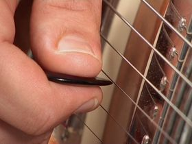 How to play pinch harmonics