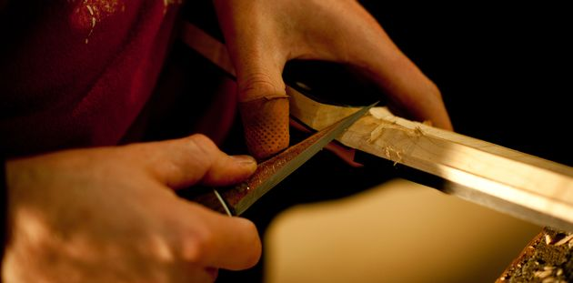 All Lowden guitar necks are carved and fitted by hand