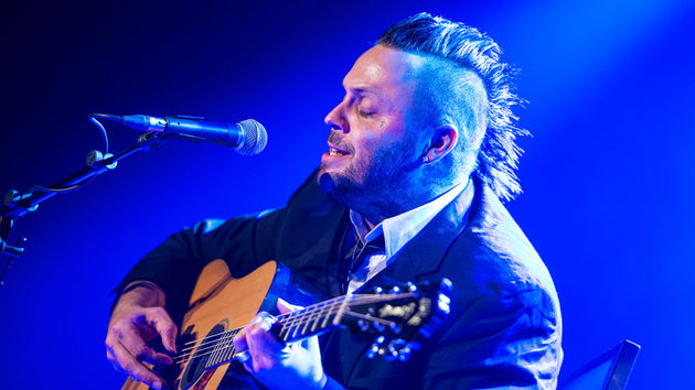 Justin Furstenfeld strums a Guild acoustic during a solo performance last April
