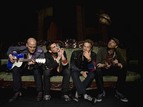Coldplay to beat recession with free live album
