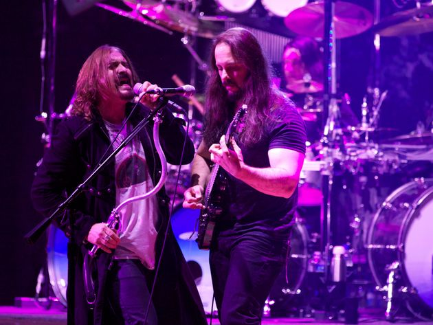 James LaBrie and John Petrucci (with Mike Mangini in back) give as good as they get