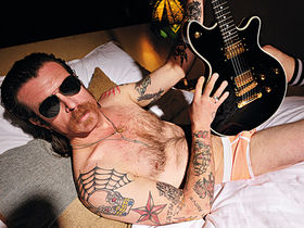 Eagles Of Death Metal frontman strips for interview