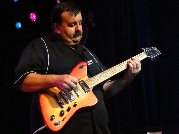 A Gibson Guitar employee demonstrates the Firebird X at New York's Hard Rock Cafe.