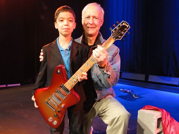Gibson Chairman and CEO Henry Juszkiewicz and a young guitar hero-in-training at the Firebird X launch