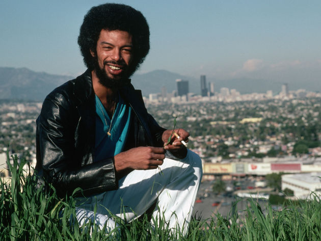 Gil Scott-Heron, relaxing on a patch of grass overlooking Los Angeles, 1980
