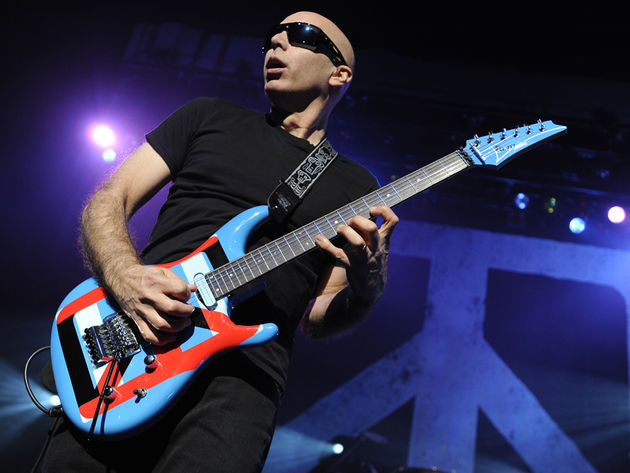 When last seen, Joe Satriani was still a one-guitar-at-a-time man