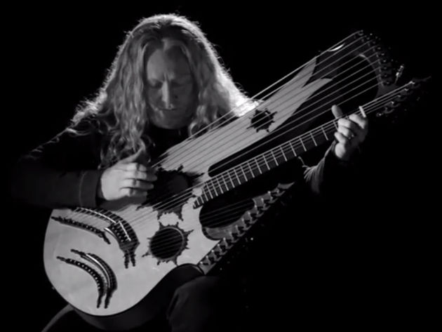 Who are those guitarists? Just one, actually - it's Keith Medley on his homemade 27-string model