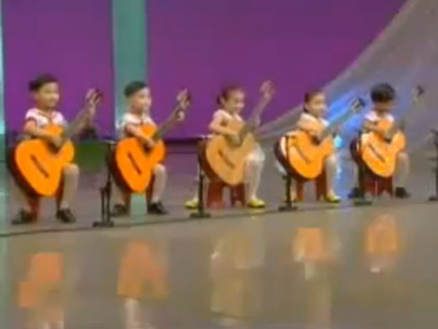 These kids should be doing their homework. On second thought, let 'em play guitar!