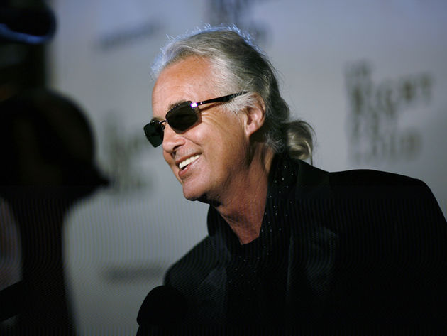 Jimmy Page arrives for a party, looking neither dazed nor confused