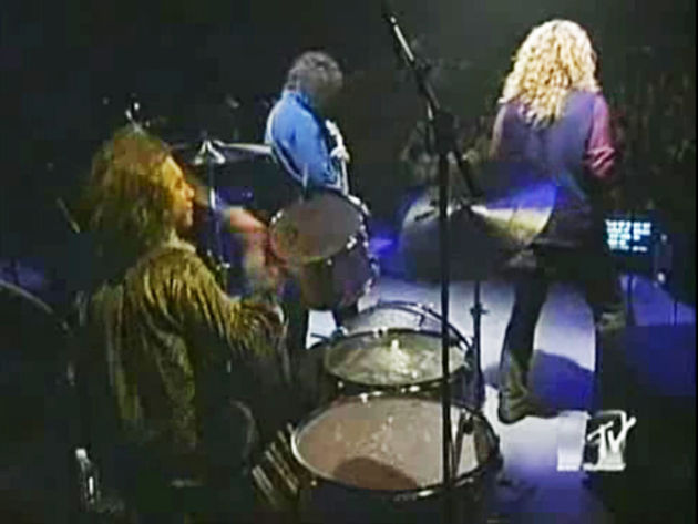 Michael Lee, seen here performing with Jimmy Page and Robert Plant for MTV in 1994